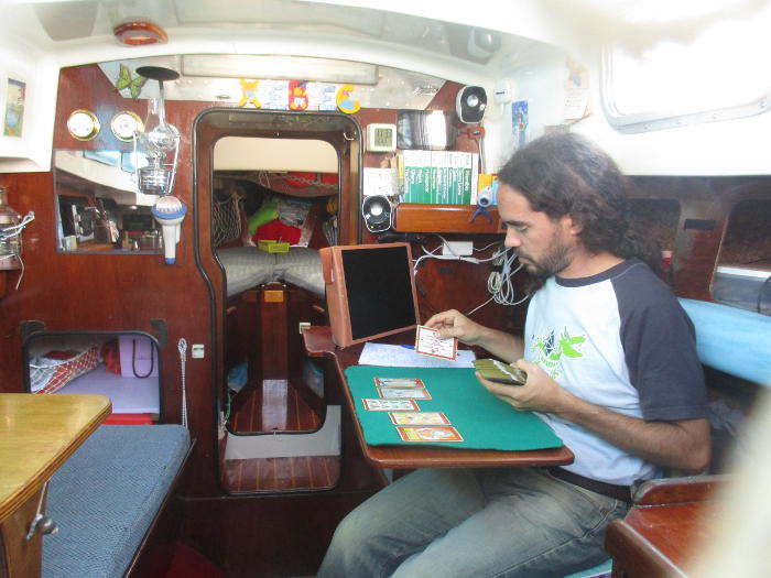 Nacho aboard Xebec doing tarot readings